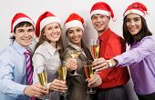 picture of merry christmas  - Portrait of smart colleagues with flutes of champagne while toasting - JPG