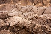 foto of mud  - Mud in layers formed by construction equipment on a jobsite - JPG