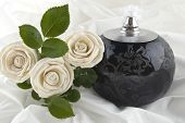 picture of funeral  - Roses and a oil lamp on satin - JPG