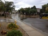PHOENIX, US - SEPTEMBER 9, 2013: Boys enjoying cool rainy day with inner