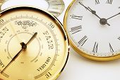 picture of barometer  - Clock and barometer dials or bezels focus on barometer face