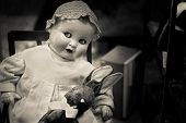 stock photo of rag-doll  - Evil Baby Doll Staring With Bunny Rag Doll - JPG