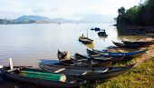 picture of coracle  - at Lak lake small bamboo crafts lay on the shore under sunlight - JPG