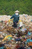 People pick up garbage at landfill