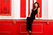Sensual Romantic Woman In Red Vintage Interior Sitting On Sill Fashion Glamour