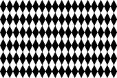 Black and white diamond pattern as background