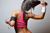 pic of sportswear  - young woman doing fitness exercises - JPG
