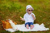 Caucasian Baby Boy Palys In Park