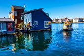 stock photo of houseboats  - Floating Home Village Blue Houseboats Water Taxi in Fisherman - JPG