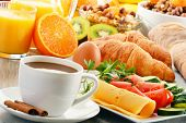 stock photo of fruit-juice  - Breakfast with coffee orange juice croissant egg vegetables and fruits - JPG