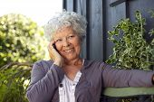 Happy Elderly Woman Making A Phone Call