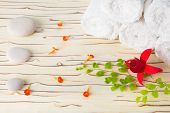 Spa Still Life With Stone, Flowers  And White Towel On Wood Background