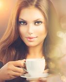 Coffee. Beautiful Sexy Girl Drinking Tea or Coffee. Beauty Model Woman with the Cup of Hot Beverage.
