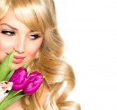 Beauty Woman with Spring Flower bouquet. Beautiful girl with a Bouquet of Tulip flowers. Isolated on