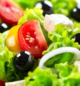 Salad. Greek Salad Background. Mediterranean Salad close up with Feta Cheese, Tomatoes and Olives. F