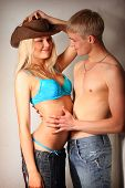 Sexy Woman And Men In Jeans