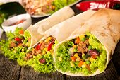pic of sandwich wrap  - Selective focus on the right burrito sandwich - JPG