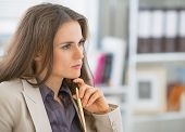 Portrait Of Concerned Business Woman Sitting In Office