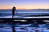 Photographer At The Sea In The Dusk