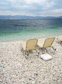 Sunbeds At Beach Of Kassiopi, Corfu, Greece