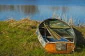 Old rowboat on the shore of a river