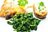Close-up Of Healthy Spinach Served With Chicken And Potato