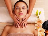 pic of low-necked  - Masseur doing massage the neck of an adult woman in the spa salon