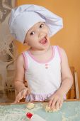 3 years old girl in cook role