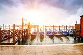 picture of gondola  - Harbor in a sunny day with gondolas in Venice lagoon - JPG