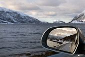Driving Along A Fjord In Winter Norway
