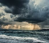 stock photo of rain  - Heavy rain over stormy ocean - JPG