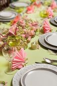 Beautiful two-tone flower arrangement in soft pink and green on a christmas dinner table
