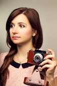 Young Hipster Woman Make A Photography With Old Camera