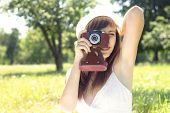 Young Woman Posing With Old Film Camera In Summer Park