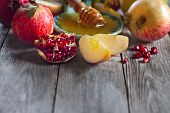 image of pomegranate  - Pomegranate apple and honey traditional food of jewish New Year celebration Rosh Hashana - JPG