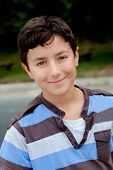 Nice preteen boy smiling with a striped shirt