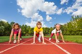 picture of knee  - Smiling children on bending knees in ready position to run marathon in summer - JPG