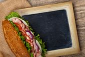 picture of deli  - Deli sub Sandwich with chalkboard - JPG