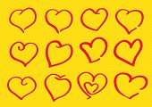 Childrens Doodles Of Heart Shapes On Yellow Background