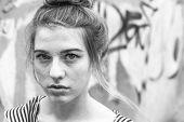 Beautiful fashionable girl close-up portrait, black and white photo.