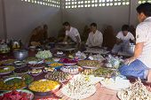 People Give Food And Drink To Buddhist Monk For Their Great Merit