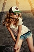 Beautiful modern girl posing outdoor. Youth style. Fashion shot.