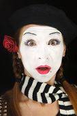 picture of clown rose  - Mime portrait with surprised face expression isolated over black background - JPG