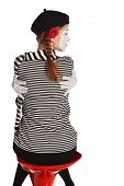 image of clown rose  - Portrait of a mime comedian girl hugging herself isolated over white background - JPG