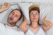 stock photo of deprivation  - Husband snoring sleep and leaves his wife - JPG