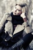 Happy blond fashion woman in autumn forest