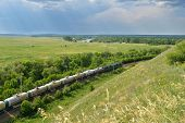 DIVNOGORIE, VORONEZH REGION, RUSSIA - JUNE 8, 2014: Freight train against the landscape of Don river. Russia holds the second place, after China, by the length of electrified railroads