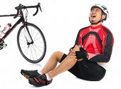 Asian cyclist fell down from bike with injured knee joint, painful facial expression and sitting on