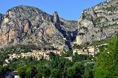 stock photo of mary  - Moustiers Sainte Marie medieval village with the golden star Alpes de Haute Provance France Provence - JPG