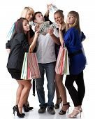 stock photo of young adult  - Group of young beautiful women with shopping bags take money from the man on a white background - JPG